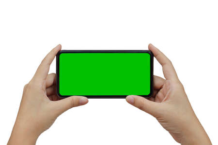 hand holding phone mobile green screen isolated on white background Standard-Bild