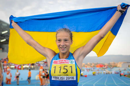 SHUKH Alina with flag during Heptathlon Girls competition (run stage) at the European Athletics Youth Championships in the Athletics Stadium, Tbilisi, Georgia, 15 July 2016 Editorial