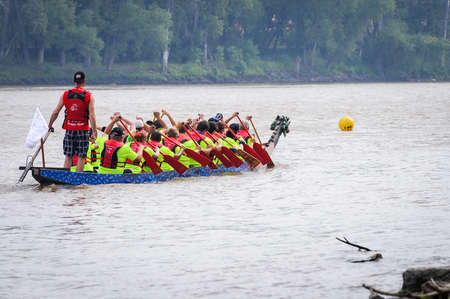 September 12, 2015 – Red river in Winnipeg, MB, Canada – Team building activity during rowing dragon boat race
