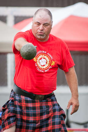 highlands region: August 15, 2015 – Winnipeg, MB, Canada -  Manitoba association of Celtic sports organized Scottish heavy games during Folklorama festival Editorial