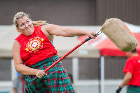 hammer throw: August 15, 2015 – Winnipeg, MB, Canada -  Manitoba association of Celtic sports organized Scottish heavy games during Folklorama festival Editorial