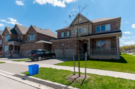 garage on house: View at new houses in a new district of the Kitchener city, Ontario, Canada