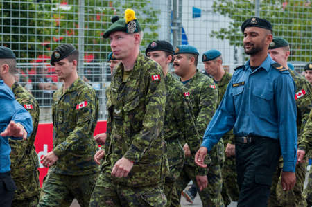 TORONTO, ON - JULY 16: Soldiers of the Canadian armed forces march along the highway during 2017 Honda Indycar Series Race in Toronto at Exhibition Place in Toronto, ON, Canada on July 16 2017