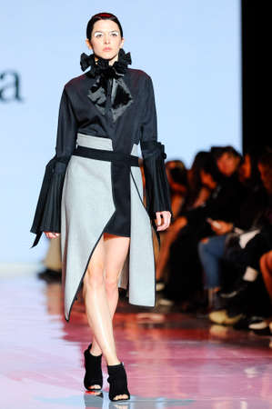 October 3, 2017. Toronto, Canada –  fashion models represents different designers clothes from Ceneca - Red collection for men and women during runway presentation at Toronto Women's Fashion Week on October 3, 2017 in Toronto, Canada Editorial