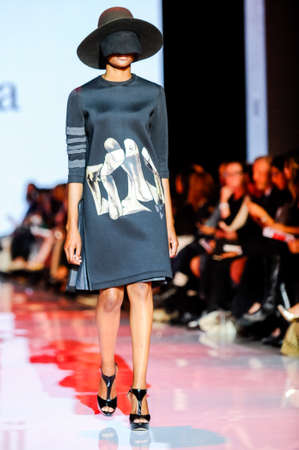 October 3, 2017. Toronto, Canada –  fashion models represents different designers clothes from Ceneca - Red collection for men and women during runway presentation at Toronto Women's Fashion Week on October 3, 2017 in Toronto, Canada Redakční