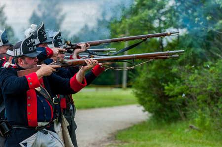 TORONTO – JUNE 17, 2017: Soldiers at the battle of Black Creek revolutionary war re-enactment in Black Creek Pioneer village in June 17, 2017 in Toronto, Canada