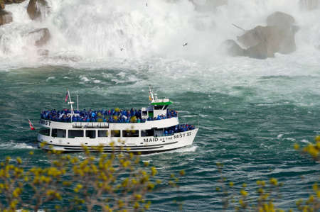 View at boat for tourists near  Niagara Falls from Canadian side at summer time Editorial