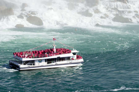 View at boat for tourists near  Niagara Falls from Canadian side at summer time Standard-Bild - 111317544