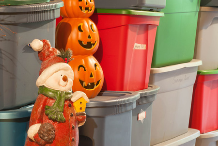 storage: Plastic storage bins, filled with decorations for various holidays. Stock Photo