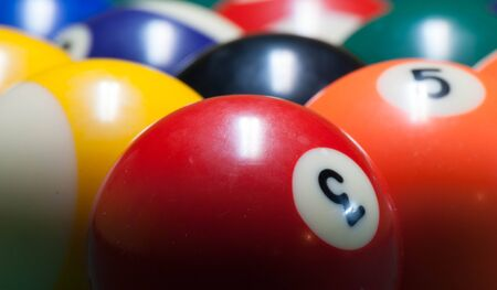 pool balls: Red three ball at the head of a rack of pool balls Stock Photo