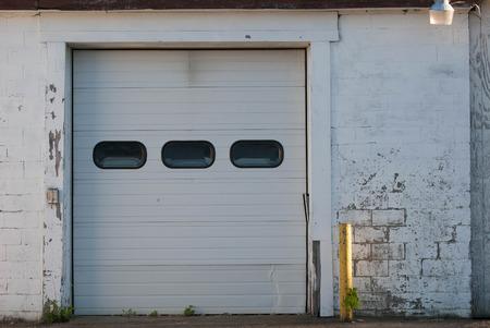 Faded brick walls and old garage door