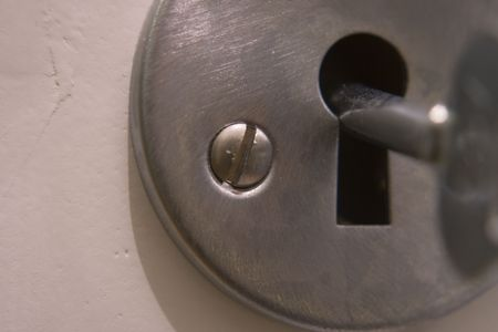 Close-up on a metallic door lock Stock Photo