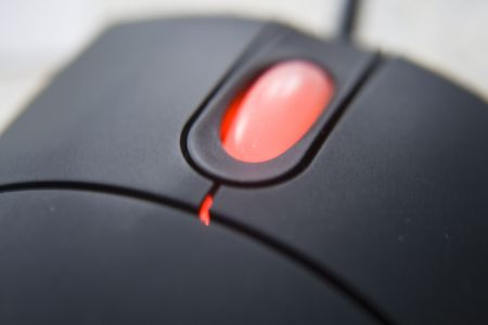 black mouse and a red wheel