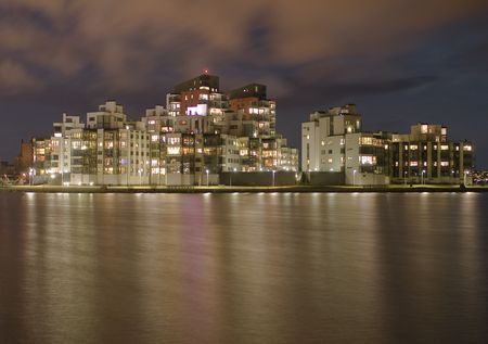 Night view of houses by the sea