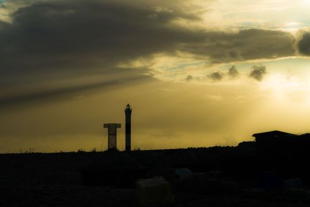 Lighthouse in a Silhuett during sunset Stock Photo