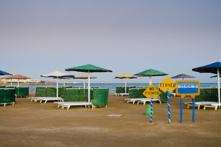 Closed beach with signs Stock Photo