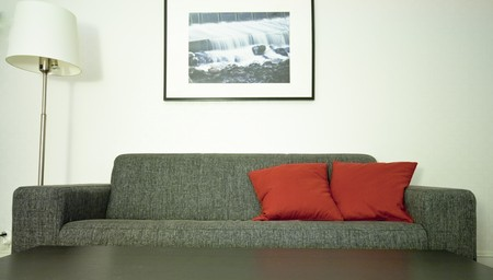 A couch and red pillow Stock Photo