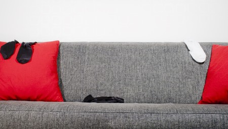 Socks in a sofa with pillows Stock Photo