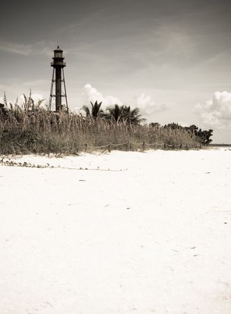 Lighthouse by the beach Stock Photo - 5777201