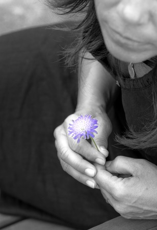 Woman holding a flower Stock Photo - 7592566
