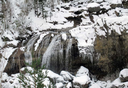 cascade mountains: waterfall in the snow