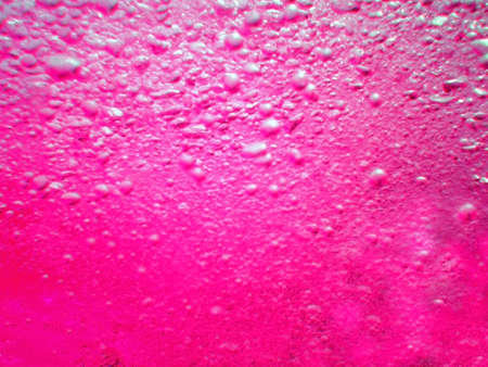 Water in the swimming pool is pink. Background. Details about water. Drops of water. Blurred. Shaded