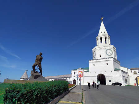 Spasskaya Tower of the Kazan Kremlin. The monument to Musa Jalil was erected in 1966 on the square in front of the main gate of the Kazan Kremlin, in memory of the Hero of the Soviet Union.