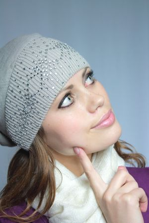 beautiful blue-eyed brown-haired woman in a winter cap