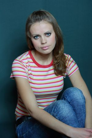 beautiful young girl in a striped T-shirt Stock Photo