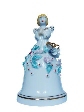 Beautiful snow-white Christmas angelic hand bell Stock Photo