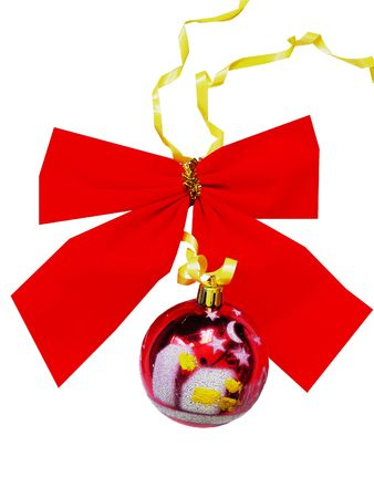 Red New Years bow with a sphere and a yellow tape Stock Photo