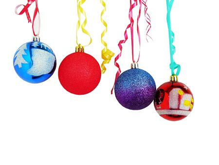 Beautiful New Years ornaments weigh on multi-coloured ribbons Stock Photo