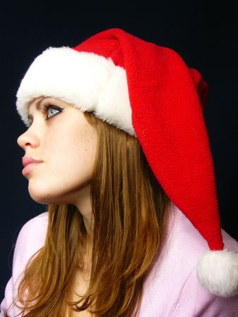 very beautiful girl in a New Years cap photo