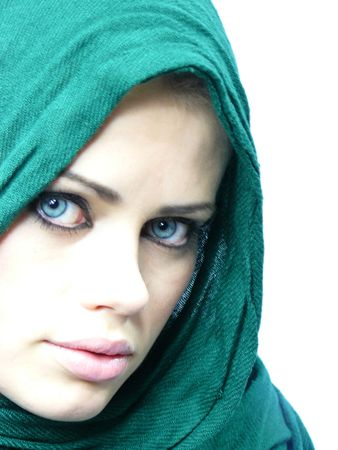 young beautiful girl in a green linen cape