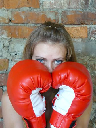 lace gloves: young beautiful girl in red boxing gloves Stock Photo