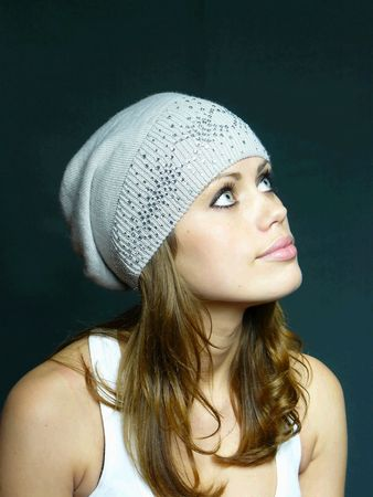 pastes:  blue-eyed girl in a grey cap with pastes