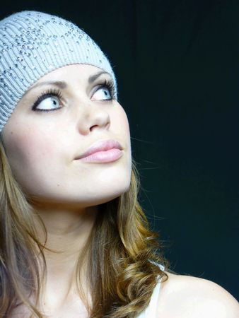 pastes:  beautiful young blue-eyed girl in a grey cap with pastes