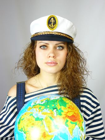 beautiful young girl and the earth globe
