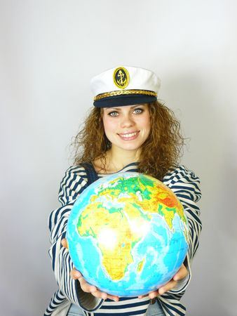 beautiful young girl with the globe in hands
