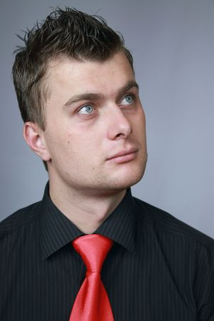 young businessman in a black shirt in a red tie Stock Photo
