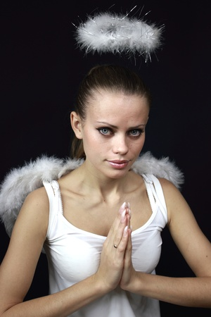 beautiful female angel on a black background