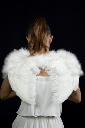 beautiful female angel on a black background