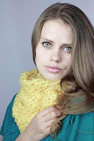 young beautiful girl in a yellow scarf Stock Photo
