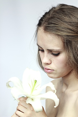 young and beautiful girl model with a white lily Stock Photo