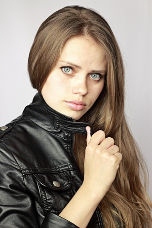 young beautiful girl to a leather jacket Stock Photo