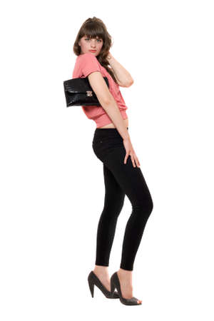 Young attractive woman in a black leggings. Isolated Stock Photo