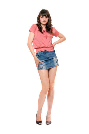 Cute girl in jeans mini skirt. Isolated photo