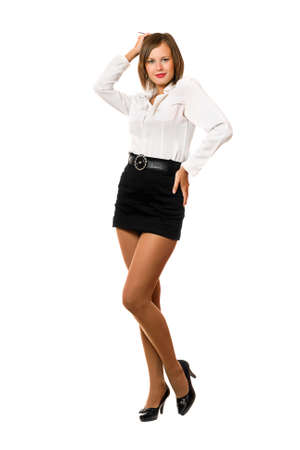 Smiling young woman in a black skirt and white shirt