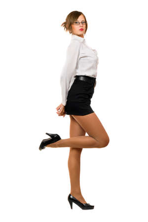 Seductive young woman in a black skirt and white shirt photo