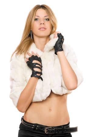 Portrait of pretty girl in a white fur coat photo